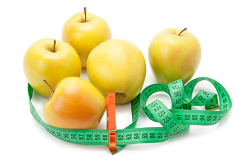 apples tape measure and clothespin