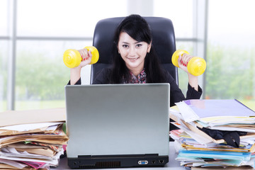 Woman working and workout in office 1