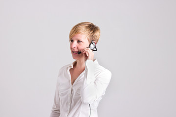 Woman Dispatcher is Communicating with Headset