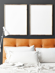 Two mock up posters on wall with bed
