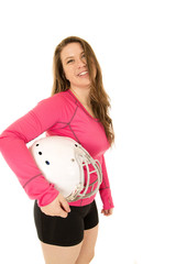 Young female model wearing pink top holding American football he