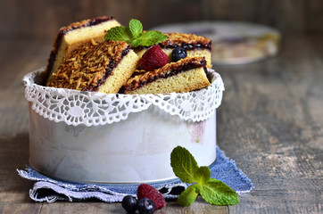 Pieces of cake with berry jam.