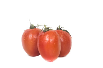 Three ripe juicy tomatoes with dew drops