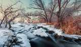Beautiful winter sunset at the river Krinka. Forest in Ukraine
