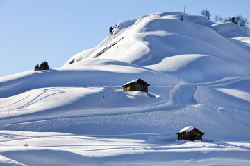 A mountain hut in winterly alpine scenery