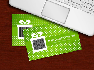 spring discount coupons with laptop lying on table
