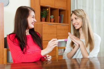 Happy women with pregnancy test