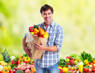 People with Vegetables over green background.