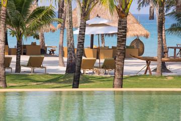 Beautiful swimming pool on a tropical beach near the sea