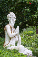 Traditional stone sculpture in garden . Bali, Ubud, Indonesia