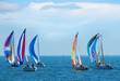 Leinwandbild Motiv Sailboat race with colorful sails