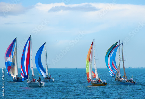 Fotobehang Kust Sailboat race with colorful sails
