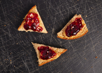 Bread with peanut butter and raspberry jelly