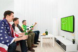 Friends Of Different Nations Watching Football Match
