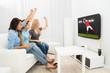 Three Women Watching Rugby Match