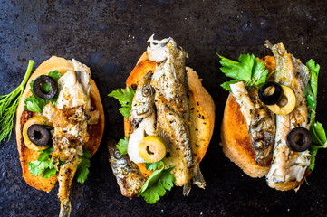Sandwiches, tapas with grilled fish