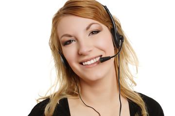 lachende blonde Frau beim telefonieren mit Headset