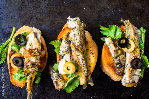 Sandwiches, tapas with grilled fish - 79421020