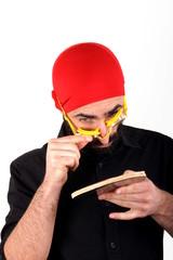 Man playing ping pong wearing swimming cap