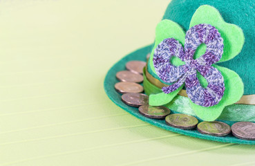 green hat with golden coins - a symbol of St. Patrick's Day