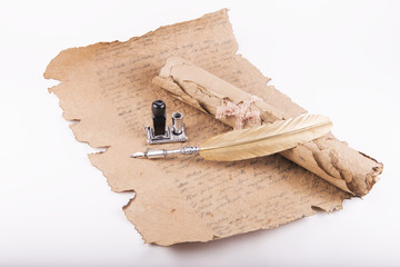 Vintage golden pen and ancient manuscripts
