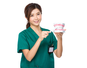 Dentist use of denture