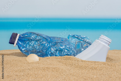 Plastic bottle on the beach - 79426082