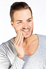 Suffering from toothache. Frustrated mature man touching face