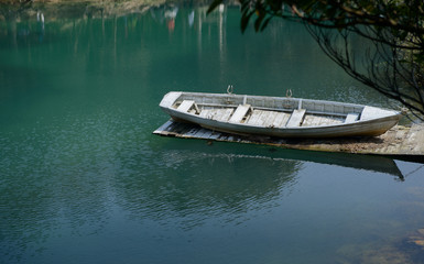 boat on a lake shore