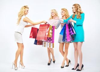 Four beautiful girls enjoying the shopping