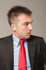 Side view picture of a young business man making