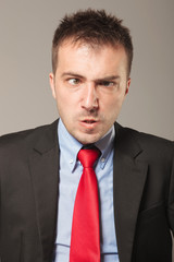 Young business man making a angry face