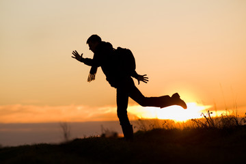 Silhouette of jumping man