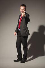 business man standing on studio background