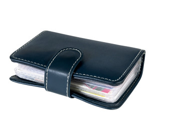 The darkly blue leather wallet with credit cards inside