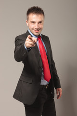 Happy business man pointing at the camera