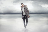 Elegant man walking on the frozen lake