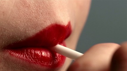 Red female woman mouth lips sexy suck a lollipop. Erotic scene