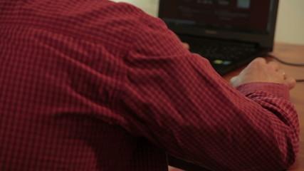 Man using laptop for searching on website. Blurred. Tilt up