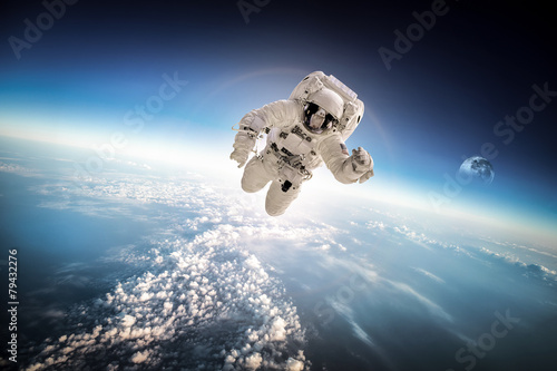 Astronaut in outer space - 79432276