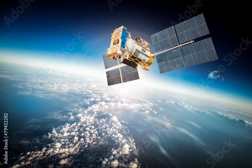 Space satellite over the planet earth poster