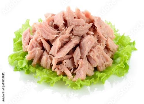 Tuna. Canned fish on green lettuce leaf - 79432895