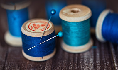 aqua spools threads on a grunge wooden table