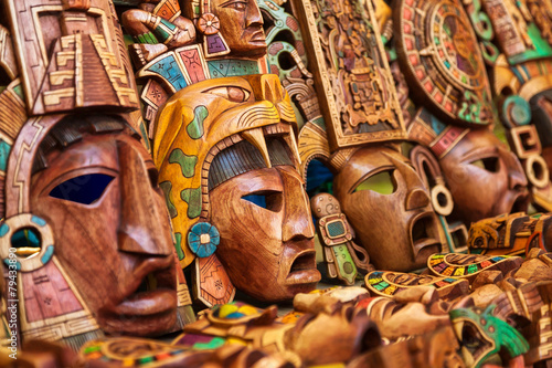 Leinwandbild Motiv Mayan wooden handcrafted masks in a traditional Mexican market
