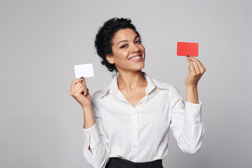 Business woman showing blank credit card