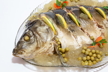 Carp cooked on a plate adorned with colorful