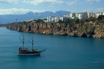 View of Antalya's coastline with tourist ship