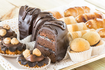 Chocolate slice of cake and mixed pastries