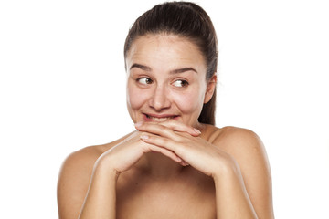 happy young woman with no makeup look to the side
