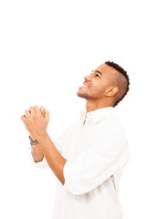 African man is praying on the floor over white isolated backgrou